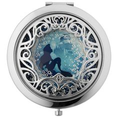 "Disney Collection Ariel Compact Mirror | Discover your inner princess with this gorgeous mirror compact mirror—embellished with a silver scrolled overlay—featuring Ariel from ""The Little Mermaid"". This magical partnership between Disney and Sephora features a series of limited-edition collections filled with fantasy and spirit."