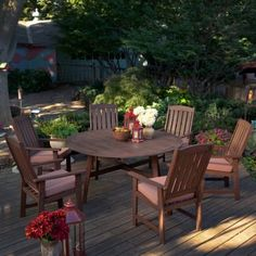 Really nice wood round patio dining table and chairs set.  Great price and free shipping.  Would look awesome out back.