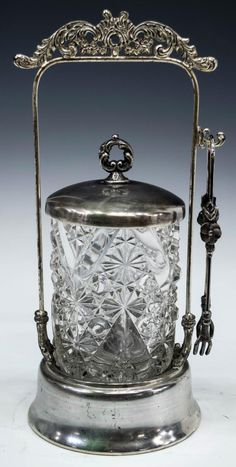 """(lot of 3) Victorian pickle castors, assembled, each having colorless molded jars, various patterns, set within silver plated frames, each accompanied by tongs and added lids, some plate loss, largest: 11.25""""h, 5.25lbs total *Provenance: Barnard's Antiques, Salado, Texas* Start Price: $80.00"""