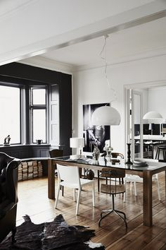 Rustic meets graphic in this beautiful dining area with dark colored windows.