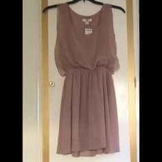 SALEMauve Flowy Dress Beautiful flowy dress. It has an elastic waist and some buttons in the back. It comes with an extra button in case one were to fall off. Issi Dresses
