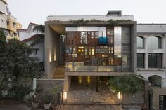 S+PSARCHITECTS adds recycled doors and windows to mumbai house façade