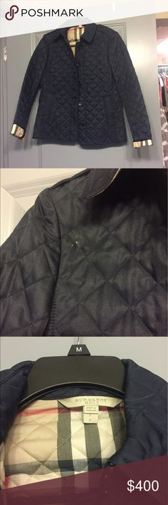 Burberry Brit quilted coat Navy quilted Burberry coat. Beautiful and classic. There is a small mark on the front that probably can come out with dry cleaning. Burberry Jackets & Coats