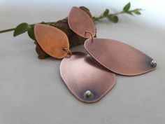 Artistic and contemporary style earrings..handcrafted from copper and sterling silver. Listed in my Etsy shop.
