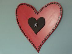 Large red heart with small black heart featuring buttons, by two dot designs