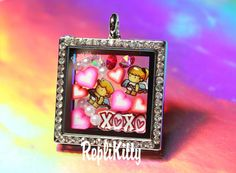 Super cute floating charm set!  Boy and girl cupid set with XOXO charms!  Hearts, crystals and pearls in a square bling locket!  Set handmade by RepliKitty!  Order individually or as a set!   Custom charms available! www.replikitty.etsy.com #cupid #angels #hearts #crystals #square #locket #floatingcharms #boy #girl #chibi #anime #ponytail #wings #baby #valentine #xoxo #gift