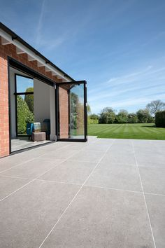 Pebble Grey porcelain stone pavers available for outdoor paving. Order your FREE sample of Pebble Grey porcelain stone tiles today! Paving Stone Patio, Limestone Patio, Outdoor Paving, Patio Slabs, Patio Tiles, Outdoor Flooring, Concrete Patio, Indoor Outdoor, Grey Pavers