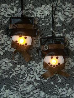 Set of 2 Steampunk Snowman Ornaments. These little guys are made using battery operated tea lights. The lights glow a gold color for their noses! Battery Operated Tea Lights, Snowman Ornaments, Secret Santa, Black Faux Leather, Christmas Crafts, Steampunk, Glow, Victorian, Crafty