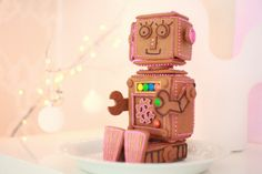 Gingerbread Robot! via Weekday Carnival. Site is in Finnish and there is no tutorial, but I may still have to try and replicate it this year! Super cute!