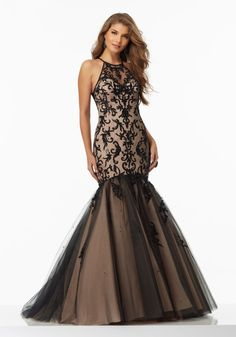 Prom Dresses by Morilee designed by Madeline Gardner. Beaded and Embroidered Prom Dress with High Scoop Neckline and Illusion Back.