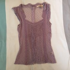 "Vintage Free People Sleeveless Top Gorgeous Free People sleeveless top with buttons that line along the back. No snags. 21"" long along the back. Free People Tops"