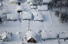 The angular roofs of houses in West Seneca, New York, turned into lumps of snow after a Tuesday night snowstorm in the region. Photo by Derek Gee/Buffalo News