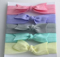 Set of 5 Easter Elastic Bow Hair Ties in Pink, Purple, Grey, Mint, and Yellow. $5.00, via Etsy.