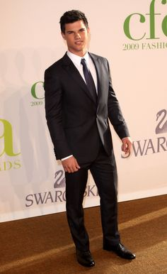 Taylor Lautner. Looking pretty spiffy in that suit there...