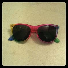 Victoria's Secret Rainbow Sunglasses (PINK) These sunglasses are rare, limited edition sunglasses that sold out online very quickly. I recieved them in stores with some sort of special offer. These have never been worn and still has the original plastic bag! Give me offers! Victoria's Secret Accessories Glasses