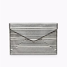 Rebecca Minkoff Striped Snake Leo Clutch: From New York fashion designer Rebecca Minkoff, the textured Leo clutch is the perfect sidekick for easy day-to-night styling featuring a stylish black and white stripe snake design. Made from Saffiano leather, this little number is designed around the classic envelope shape and features an edgy metal zip detail around the outside. With a magnetic envelope snap closure and fully lined interior with Rebecca's exclusive textile, complete with…