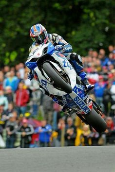 "Austrailian Josh Brookes on the Tyco Suzuki GSX-R 1000 jumping ""The Mountain"" at the Cadwell Park park round of the British Super Bike series."
