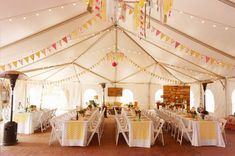 Whimsical wedding reception with garlands and chevron details