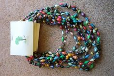 These awesome bright colored paper rolled necklaces are made by women in Uganda! Jewelry with a cause, style with purpose