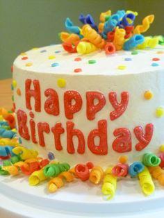 Confetti & Curly Ribbon Birthday Cake, via Flickr.