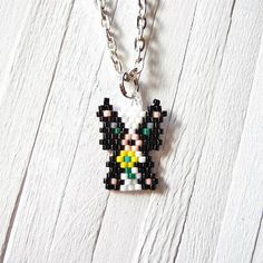 This little beaded skunk is smelling quite sweet for you.    Tiny professional quality Miyuki Delica seed beads are hand stitched together in the