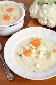 Delicious chunky cauliflower soup with lots of tasty veggies - cauliflower, potatoes and carrots with an extra kick of cream and grated cheese!
