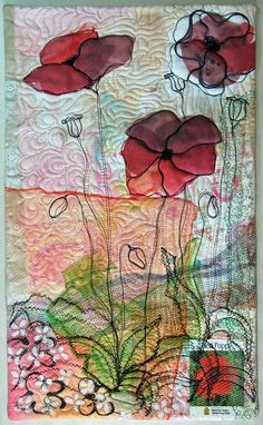 Red Poppy. that black netting at the bottom and the packet of poppy seeds really makes this quilt interesting.