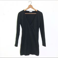 Tobi Black Wrap Dress TOBI long sleeve black dress with a deep v neck. 95% cotton, 5% polyester. Size small. Fitted to the body. Tobi Dresses Long Sleeve