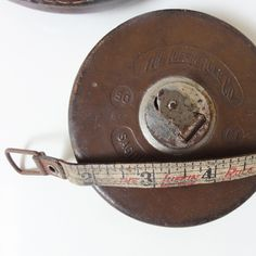 Dad's old tape measure. Still have it. Works great!