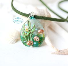 Teal green ocean jewelry, Blue green seashell pendant, One of a kind handmade lampwork glass nautical jewelry Beach Jewellery, Ocean Jewelry, Nautical Jewelry, Green Ocean, Teal Green, Sea Glass Necklace, Sterling Silver Chains, Glass Beads, Pendant