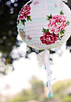 paper lantern from Gypsy Purple home......with drippy ribbons. Would also look pretty with crystals hanging from the bottom