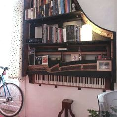 A bookshelf made out of the carcass of an old grand piano (found this on Facebook, don't know who made it).