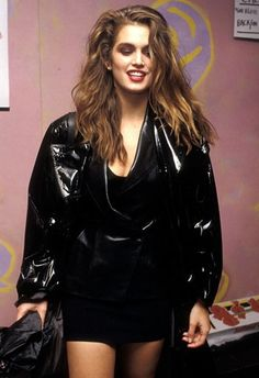 Cindy Crawford wearing a black patent jacket in 1989