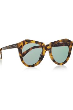 Karen Walker's 'Number One' sunglasses are crafted from tortoiseshell acetate with geometric frames and green lenses. We love this oversized pair styled with off-duty looks. Shop it now at NET-A-PORTER.COM. #KarenWalker