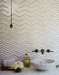 Are we still loving chevron!? This mosaic would add a splash of detail behind your bathroom vanity! #TileSensations