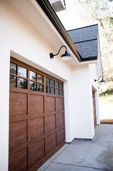 Installing goosenecks as garage lighting will establish an iconic yet still modern curb appeal. Photo courtesy of The Wilsons Build and Permanent Glimpse Photography Garage Ideas for Garage Lighting Garage Door Styles, Wood Garage Doors, Modern Garage Doors, Garage Door Lights, Exterior Garage Lights, Outdoor Garage Lights, Black Outdoor Lights, White Garage Doors, Garage Door Paint