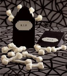 pretzel sticks, mini marshmallows, white chocolate. Super cool idea for halloween snacks.