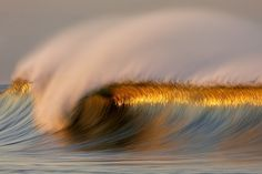 Sunset reflection captured in wave