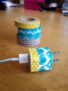 Quick & Easy DIY: Washi Tape Apple Charger.  This would help so I don't mix mine up with others.