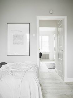 lovely white toned bedroom and the black Arne Jacobsen chair in the other room - love it !