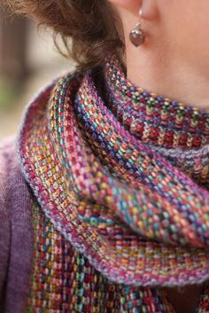 """Missoni-esque scarf. Looks like linen stitch using multiple colors of variegated yarns - one color per row. Knit lengthwise. Liked that the knitter knit into the back of the loop of the first and last stitches to tighten them."""