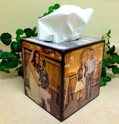 Why not personalize things already in your house? Photo's on a tissue box is perfect to display your photo's!