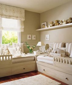 twin beds - L shape arrangement cute arrangement and leaves lots of open space in room for playing or whatnot.
