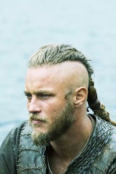 "Travis Fimmel as Ragnar Lothbrok in""Vikings. Vikings Travis Fimmel, Ragnar Vikings, Vikings Show, Vikings Tv Series, Vikings Actors, Lagertha, Viking Braids, Mens Braids, Viking Haircut"