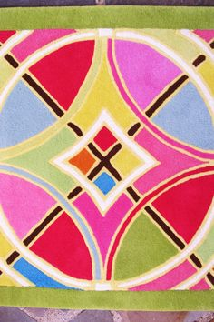 beautiful, colorful, custom made rug! Rainow! hot pink, bright blue, green, yellow, orange, red, light pink and white designs! LoLo Moore Design Custom Rugs