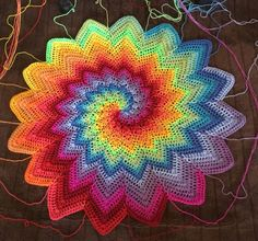Best 12 ‎Kylie Parmenter‎ to CROCHET ADDICT WIP Yaaaa finally lm happy with the color pallet and go with the flow pattern in my head for my swirl rainbow throw! I love how the image in my head of what l wanted to do is turning out the way it has! Crochet Mandala Pattern, Afghan Crochet Patterns, Crochet Doilies, Crochet Flowers, Crochet Stitches, Knitting Patterns, Crochet Star Blanket, Crochet Afghans, Crochet Home
