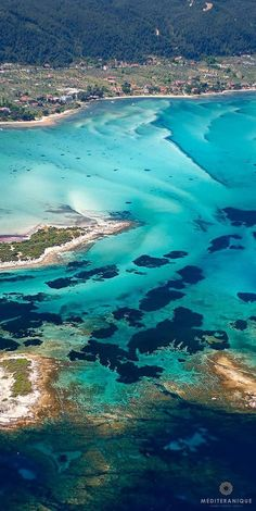 Crystal clear cobalt and turquoise waters in   Halkidiki, Northern Greece.