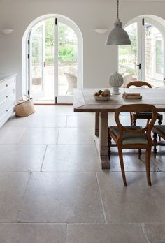 The Dijon tumbled limestone floor tiles add a truly classical English feel to a kitchen or bathroom. Order a free sample online today at Mandarin Stone! Home, Stone Kitchen Floor, House Flooring, Limestone Tile, Stone Kitchen, Flooring, Stone Tiles Kitchen, Minimalist Kitchen Design, Stone Tile Flooring