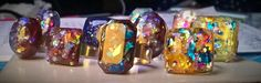 Anelli semplici nickel free aperti regolabili con opalini in resina di mia fattura. --- Nickel free open adjustable simple rings with my medium to small opals. https://www.facebook.com/media/set/?set=a.887110798074276.1073741840.692468317538526&type=3