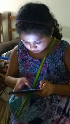 The face of the new generation is illuminated by tablets.